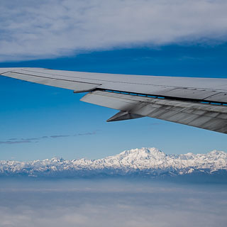 view from the plane of Alps mountains and Monte Rosa, with Boeing 767-400ER wing with raked wingtips