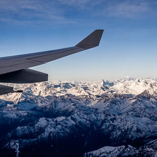 Aerial view of Matterhorn and Mont Blanc mountains in the Alps with wing