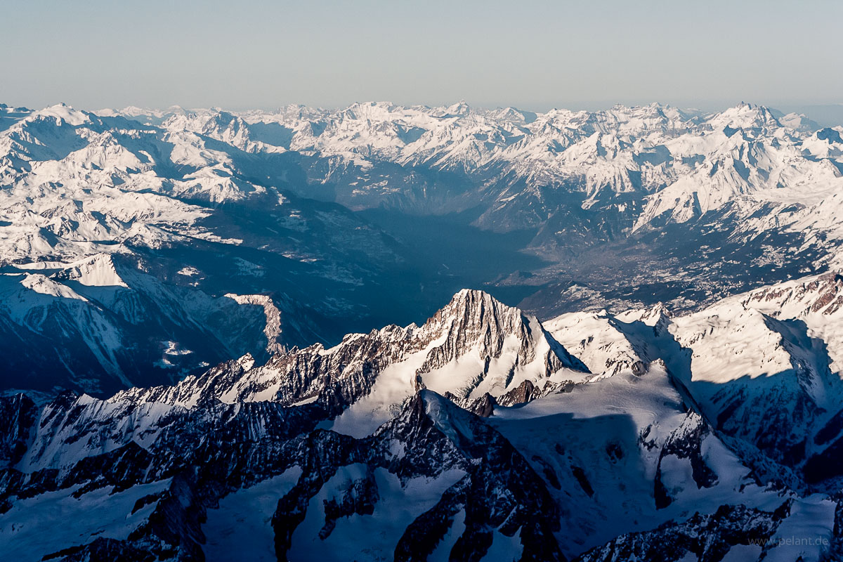 Aerial view of the Bietschhorn mountain and the Rhone valley behind