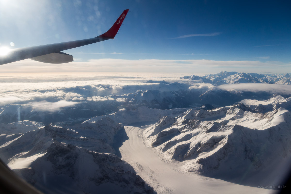 Aerial view of the Aletsch Glacier in the Bernese Alps with the Matterhorn and the Monte Rosa massif at the horizon