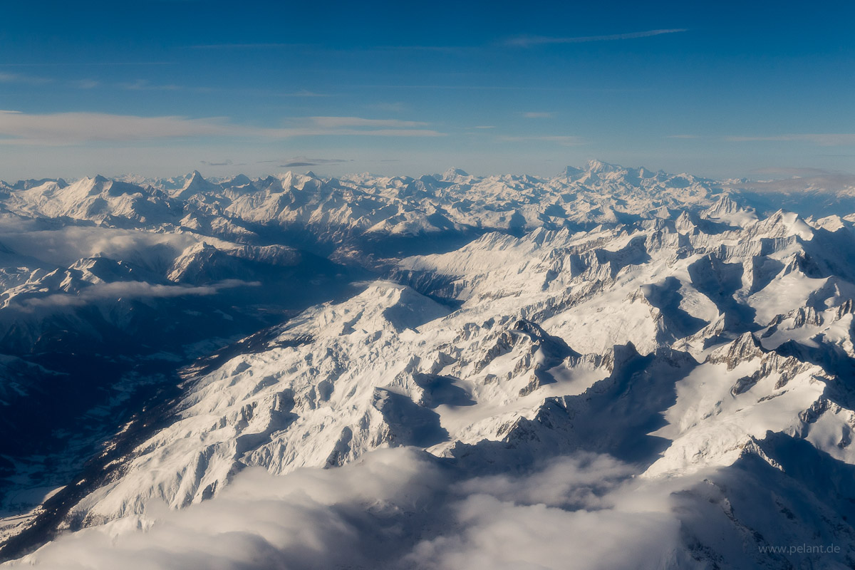 Aerial view of the Rhone Valley. Matterhorn and Mont Blanc at the horizon. Picture of the Swiss Alps in Winter taken during flight from Zürich to Sion.