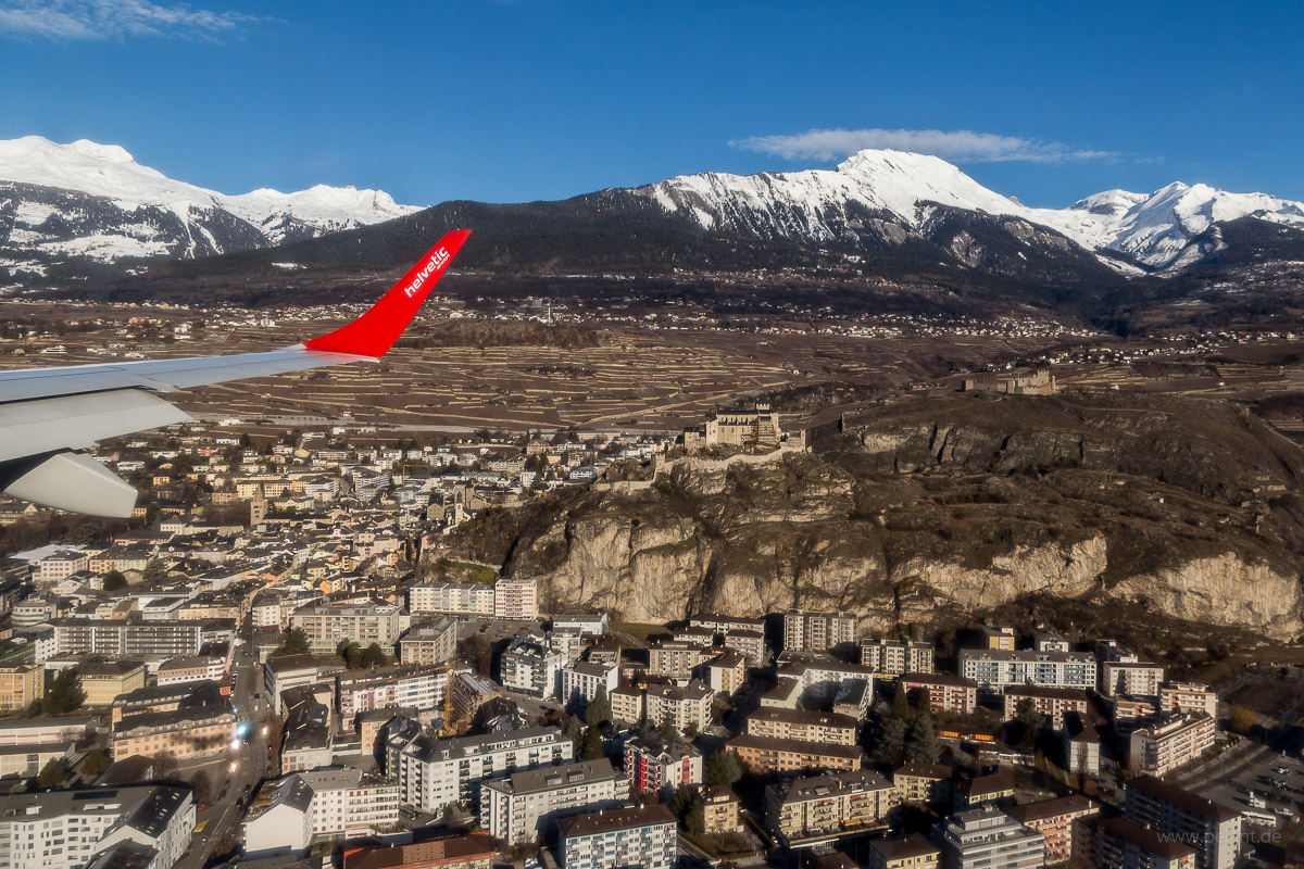 Aerial view of Sion during approach of Sion Airport (from ZRH) with Helvetic Airways Embraer 190 with its winglet visible in the image