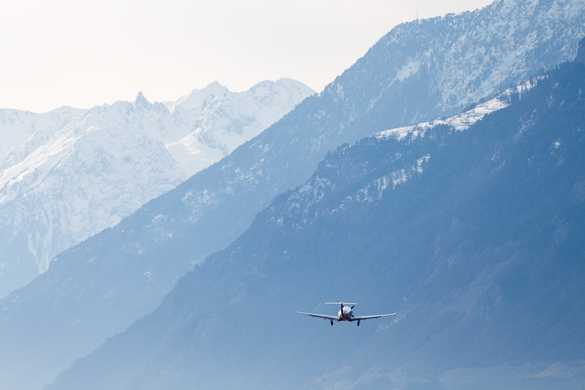 An airplane (OO-PCI, Pilatus PC12/47E) departs from Sion Airport (SIR)