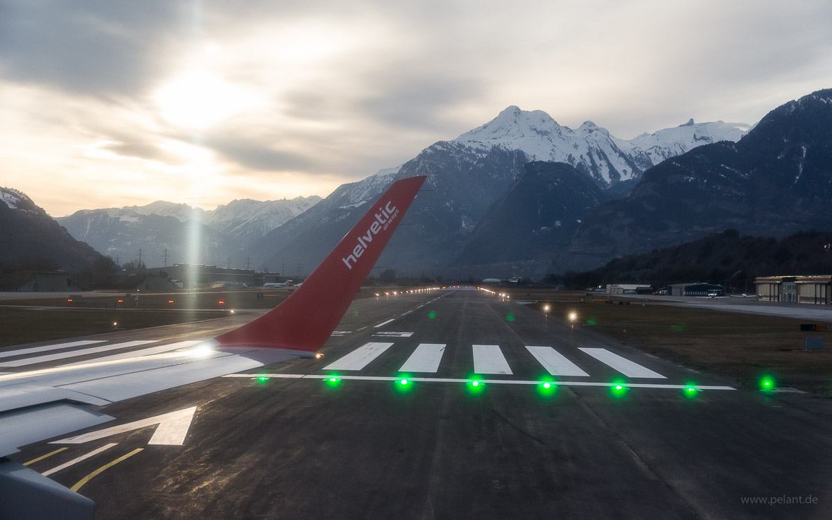 HB-JVO Helvetic Airways Embraer 190 taxies to the runway 25 of Sion Airport (SIR) for departure to Zürich ZRH