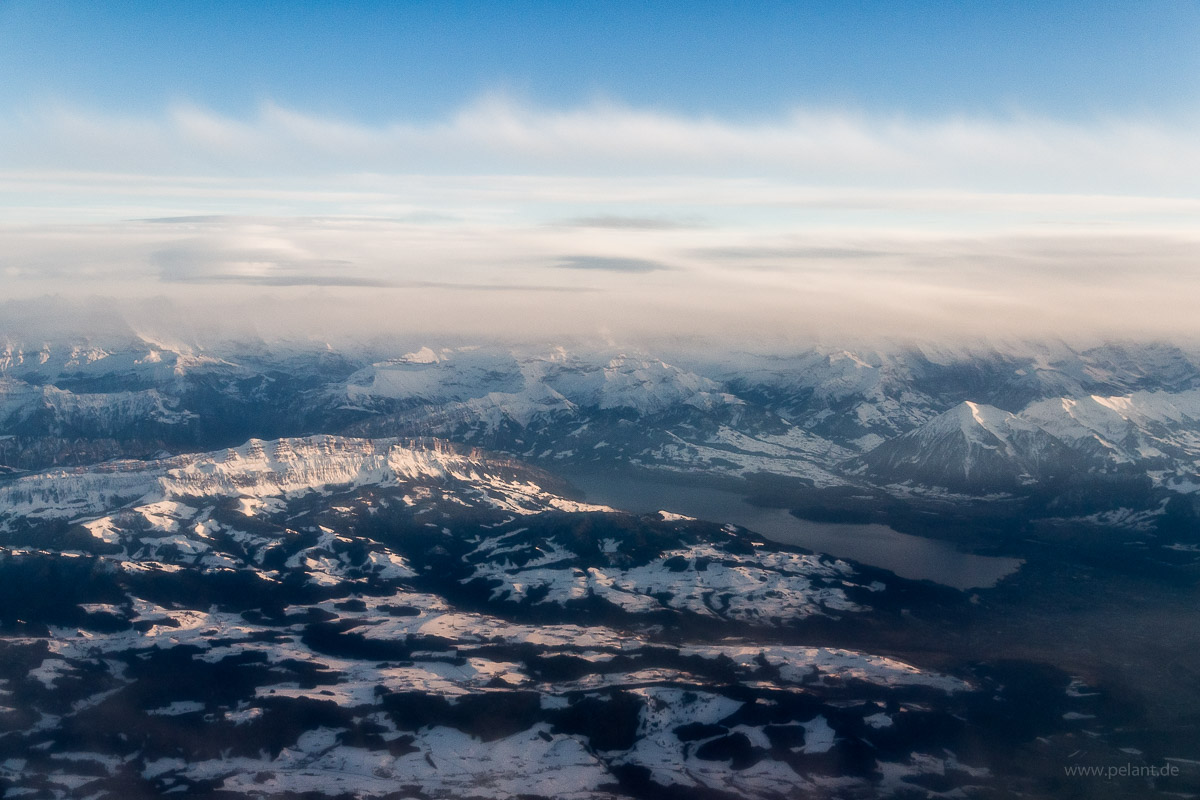 aerial view of the Thunersee with the mountain ridges Sigriswilgrat and Güggisgrat; Swiss Alps in winter