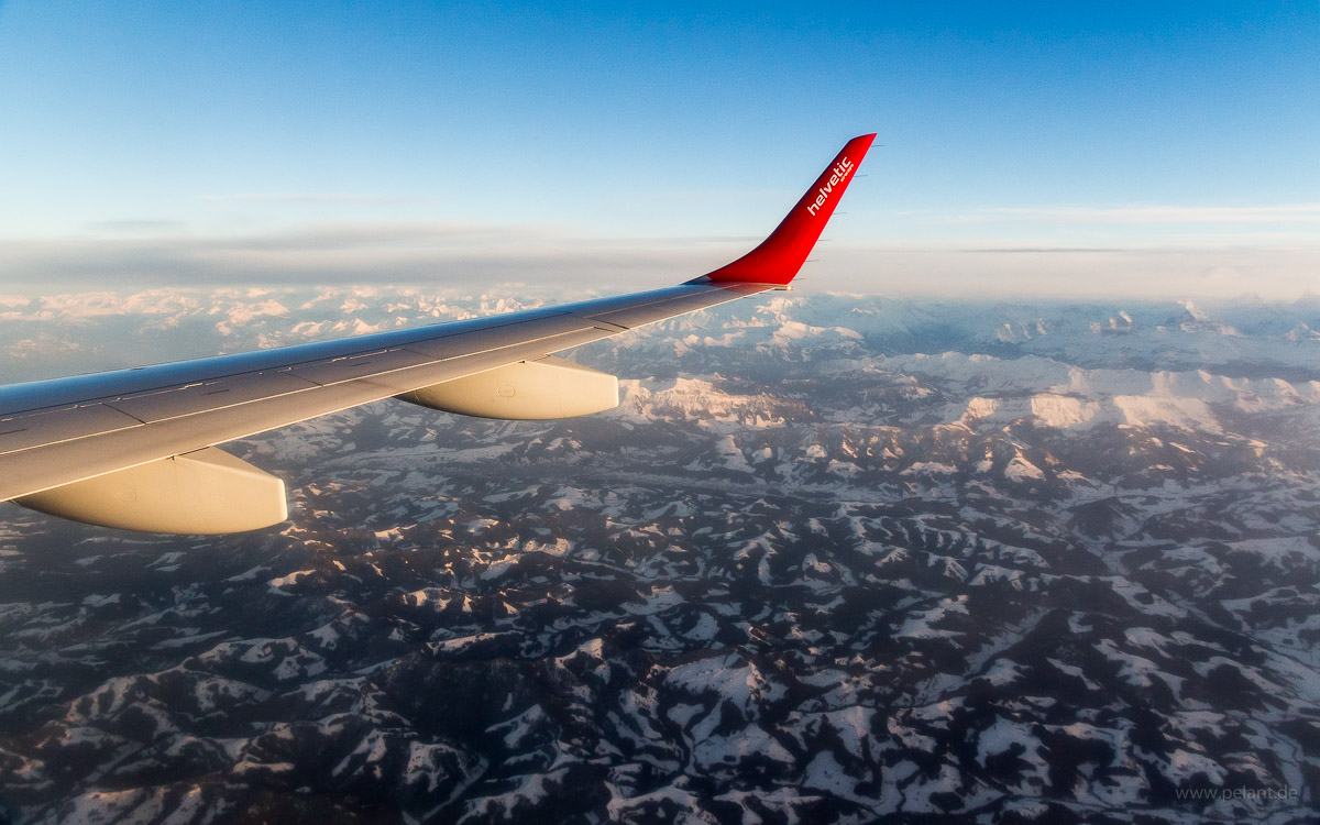 aerial view of Swiss Alps taken from Helvetic Airways Embraer 190 with winglet in the image