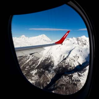 View from an airplane window of the Bernese Alps during flight from Zürich to Sion