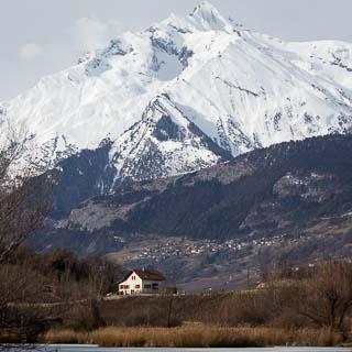 View of the Haut de Cry over the frozen Lac du Mont d'Orge