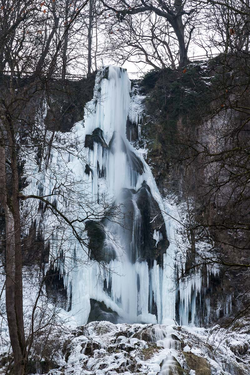 frozen Urach waterfall in winter