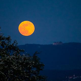 moonrise over the Schwäbische Alb with Hohenneuffen castle ruin