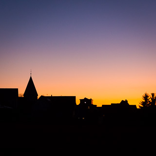 silhouette of Walddorf at dusk