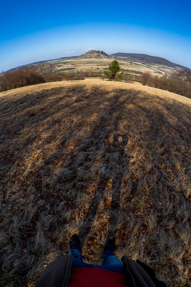 fisheye lens view of the Kornbühl hill with photographer´s shadow