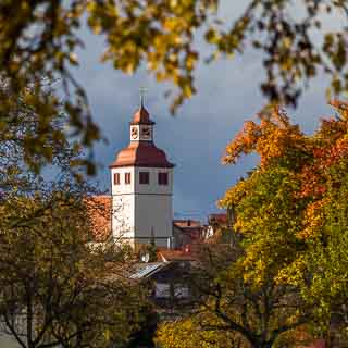 view through orchard of the church tower of Grabenstetten