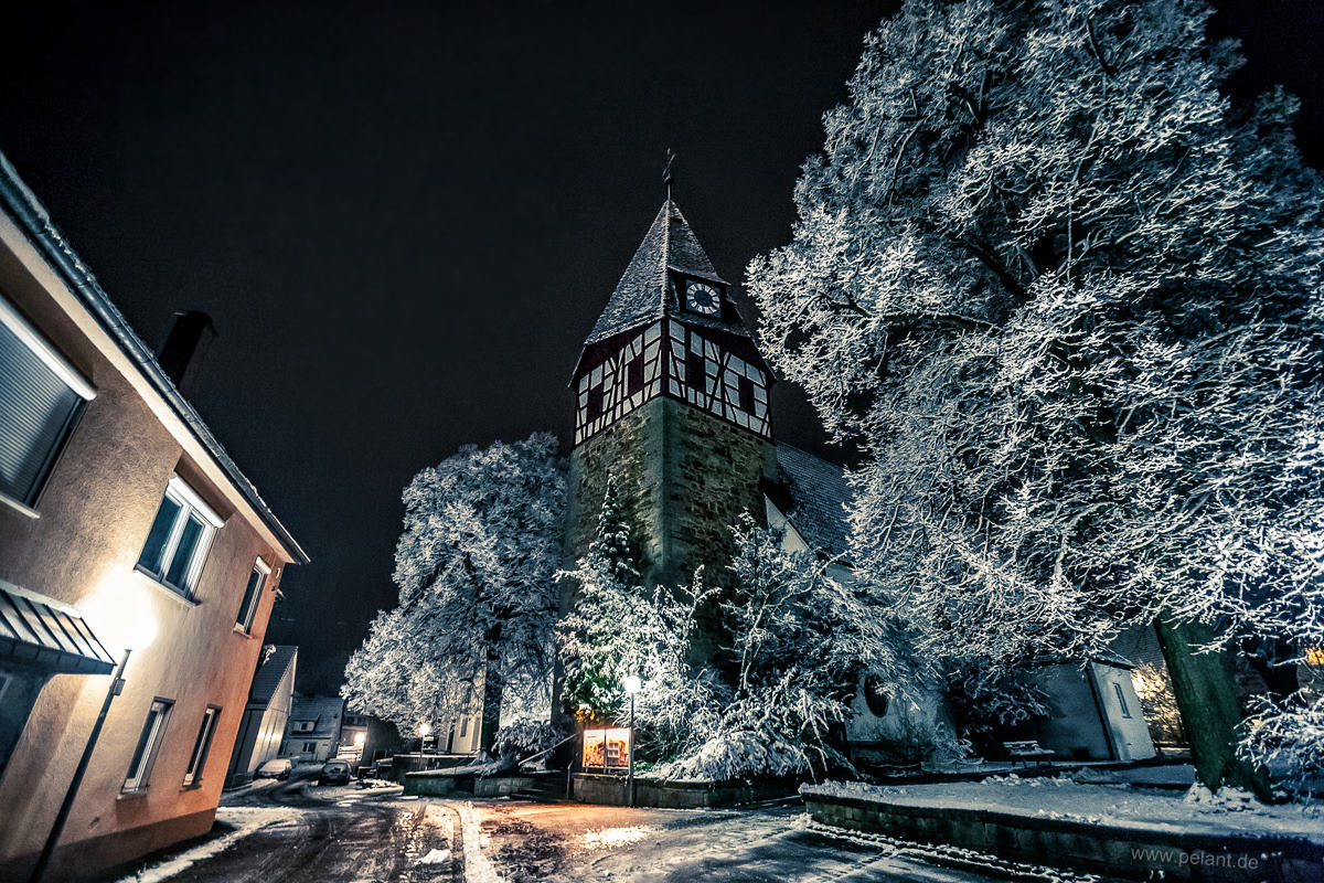 church of Walddorf in a winter night with new snow
