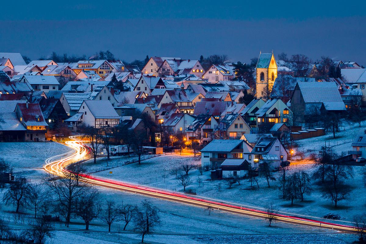 Schlaitdorf at dusk in winter with snow
